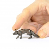 Miniature bronze walking fox sculpture