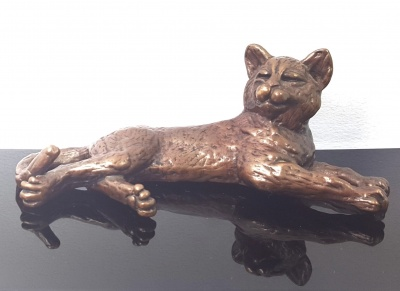 Bronze lying cat sculpture