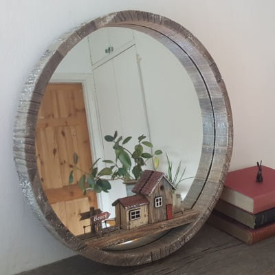 Round mirror with beach huts