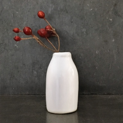 Little pottery milk bottle vase
