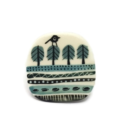 Porcelain brooch - Bird on trees in fields
